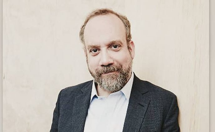Paul Giamatti in a black suit and white shirt.