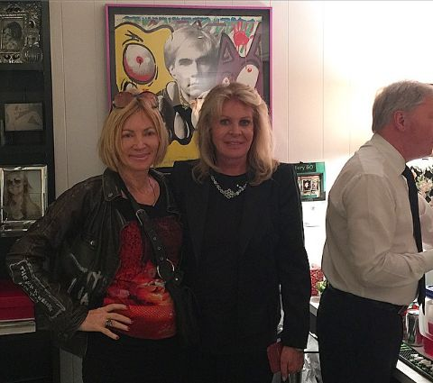 Karen Bystedt with Elaine Callei Kares in her art gallery.