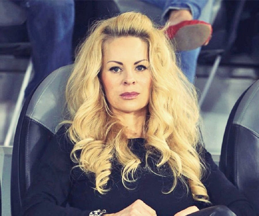 Helena Seger watches a football match from the VIP seating.