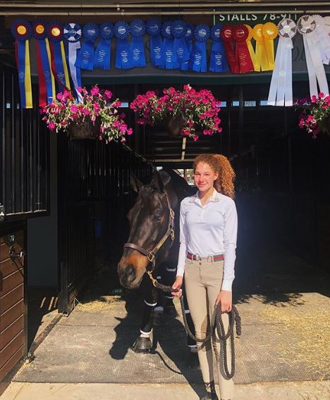 Sophia Strahan standing with her horse Zeus on 27 May 2019