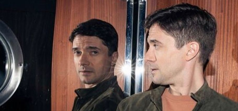 Topher Grace looking at the mirror.