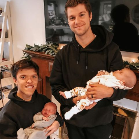 Zach and Jeremy Roloff with each other's kids.