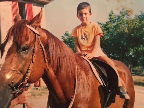 Matteo Bocelli riding a horse at age 5.