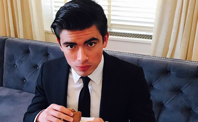 Michael Joseph Consuelos wearing a black suit with white tees.