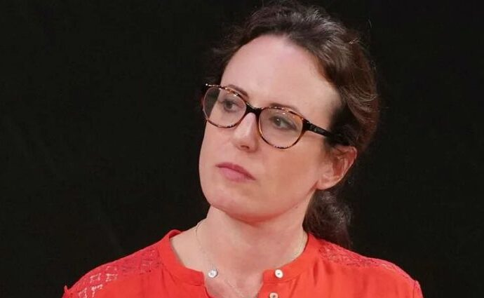 Maggie Haberman wearing a red tee.