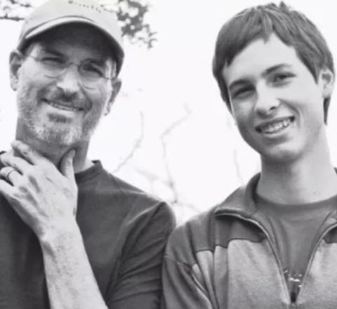 Reed Paul Jobs with dad Steve Jobs.