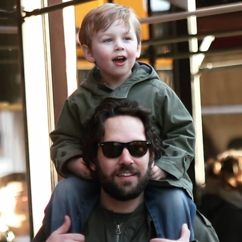 Paul Rudd holding his son, Jack Rudd over his shoulder.
