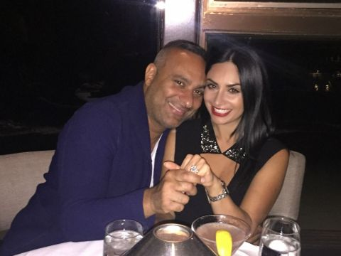 Russell Peters and Ruzanna Khetchian showing off their engagement ring.