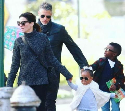 Sandra with her partner and kids.