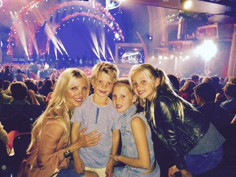 Layla with her three kids at a concert.